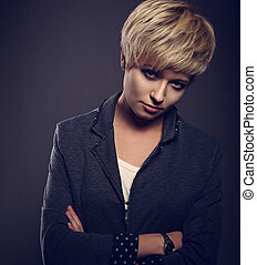 Beautiful sexy cocky woman with short bob blond hairstyle in fashion jacket on grey background. Closeup toned portrait