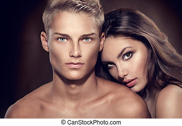 Beautiful sexy couple portrait. Model man with his girlfriend posing together