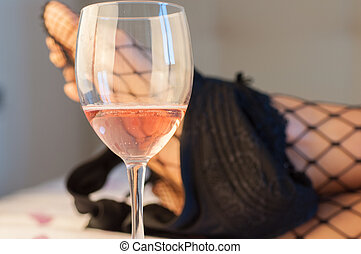 beautiful sexy detail of a sensual girl with a glass of wine