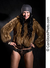 Beautiful sexy female in fur coat