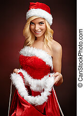 Beautiful sexy girl opens Santa Claus gift sack Beautiful...