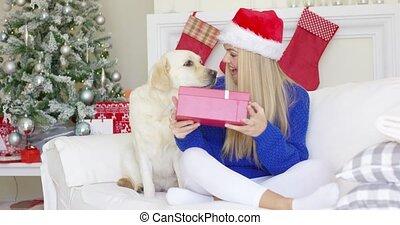 Beautiful sexy girl sitting at christmas time on sofa