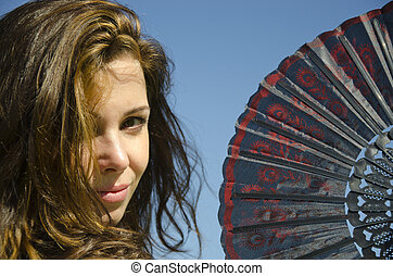 Beautiful sexy girl with Spanish folding fan - Close up of...