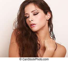 Beautiful sexy long hair woman with closed makeup eyes