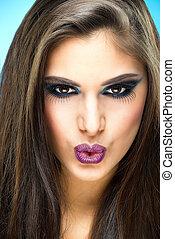 Beautiful, sexy makeup model, send a kiss