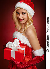 Beautiful sexy santa claus girl with gift box