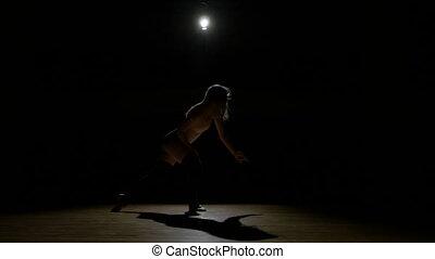 Beautiful sexy silhouette dancer girl rehearsing