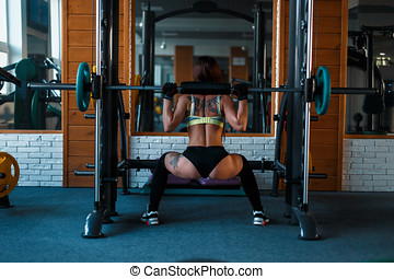 Beautiful sexy woman doing exercise in the gym