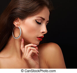 Beautiful sexy woman face profile with closed eyeliner eyes. Closeup portrait
