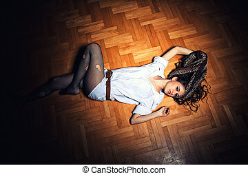 Beautiful sexy woman on wooden floor