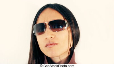 beautiful sexy woman with sunglasses nods to the beat of the...
