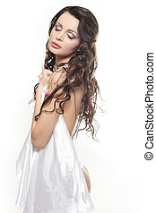beautiful sexy young brunette girl covered with bed sheet...