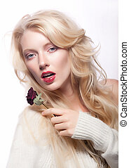 Beautiful sexy young female blonde with red flower