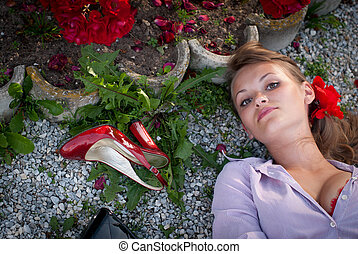 sexy young woman lying on the ground