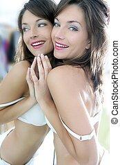 Beautiful sexy young woman posing mirror