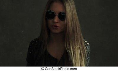 beautiful sexy young woman smoker, girl smoking cigarette in studio. Backstage photo short
