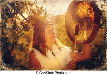 beautiful shamanic girl playing on shaman frame drum in the ...
