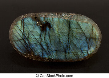 Beautiful shimmering slice of the mineral labradorite -...