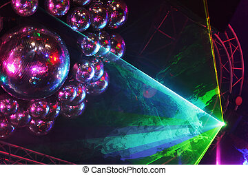 Beautiful shiny balls and colorful rays on ceiling in night...