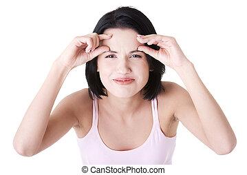 Beautiful shocked woman checking her wrinkles - Beautiful...