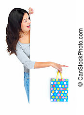 Beautiful shopping Christmas woman with bag isolated on white background.