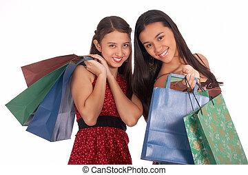 Beautiful shopping girls holding lots of shopping bags