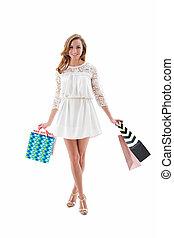 Beautiful shopping woman holding shopping bags