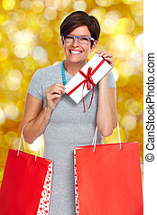 Beautiful shopping woman with envelope gift.