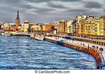 Beautiful shore of Rhein river during day in Dusseldorf in...