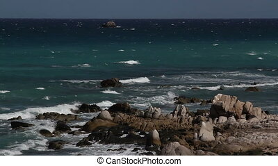 beautiful shot in los cabo, baja california sur mexico where the desert reaches right down to the pacific ocean. there is an amazing quality of light around this area