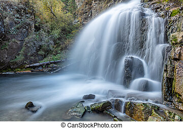 Beautiful shot of Kamischlinskiy waterfall in Altai mountains in Siberia, Russia. Smooth, silky water. Long exposure.