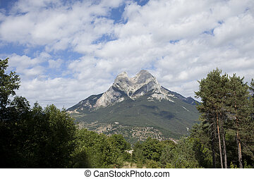 beautiful shot of the magical pedra forca mountain in spain, with perfect summer clouds