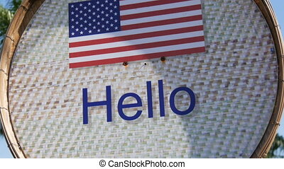 Beautiful sign with American flag with the inscription Hello...
