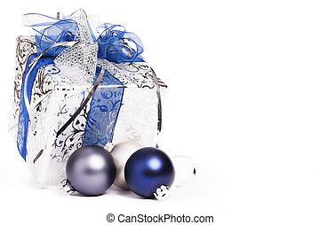 beautiful silver christmas present with blue ribbons and blue and silver christmas balls on white background