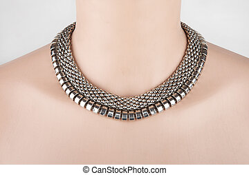 Beautiful silver statement necklace on a mannequin
