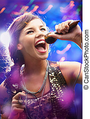 Beautiful singer - Portrait of a glamorous girl with mike ...