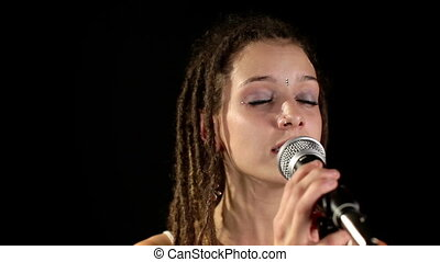 beautiful singer with dreadlocks, including high quality audio captured with the zoom H4 microphone