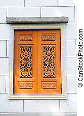 Beautiful single Chinese wooden window closed on wall