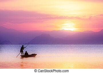 Beautiful sky and Silhouettes of Minimal fisherman at the lake in pastel color.