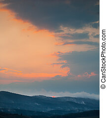 Sunset clouds in the mountains
