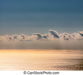 beautiful sky with sun rays through clouds