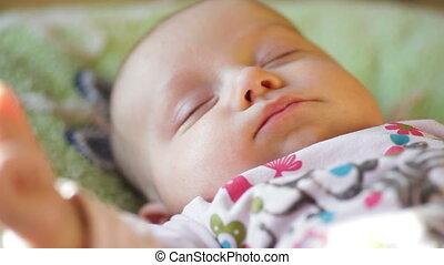 beautiful sleeping baby - close-up portrait of a beautiful...