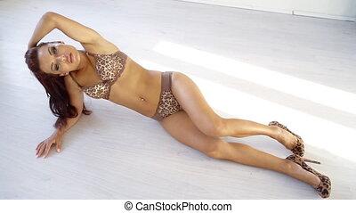 beautiful slender girl in underwear lying on the floor 1