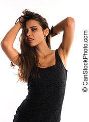 Beautiful slender Romanian woman in a short black dress