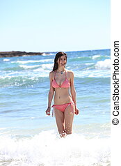 Beautiful slender woman in a bikini bathing