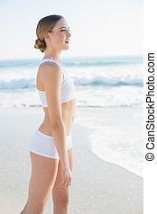 Beautiful slender woman looking away