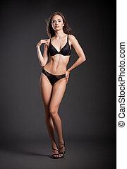 Beautiful slim brunette in lingerie. - Portrait of a...