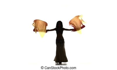 Beautiful slim exotic belly dancer girl with two long fans and shaking her hips, on white, silhouette, shadow