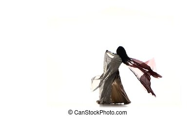 Beautiful slim exotic belly dancer with two wings and shaking her hips, on white, silhouette, shadow