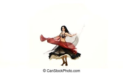 Beautiful slim exotic belly dancer with two wings and shaking her hips, on white